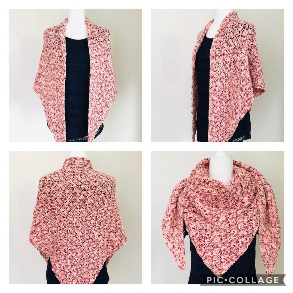 mannequim showcasing a pink triangular crocheted shawl